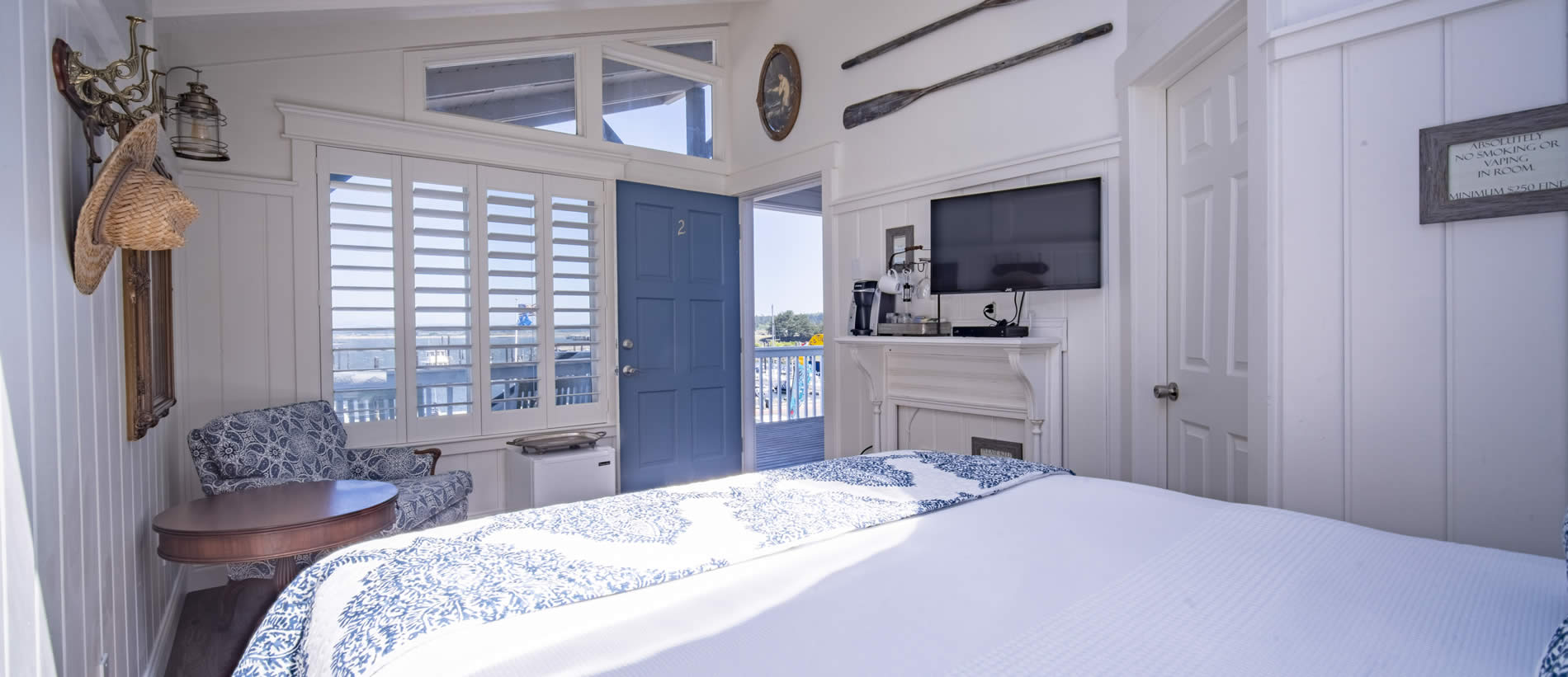 room two with queen bed and harbor view